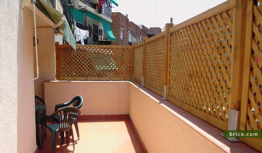 Celosías de madera en balcón